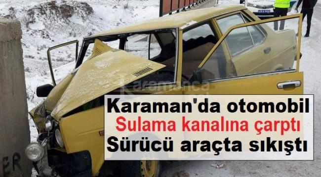 Karaman'da sulama kanalına çarpan otomobilin sürücüsü sıkıştı