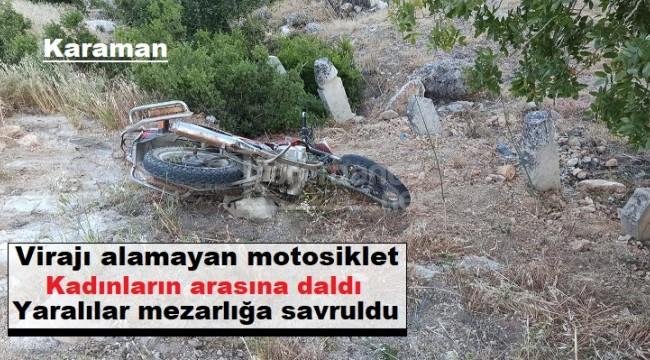 Karaman'da virajı alamayan motosiklet kadınların arasına daldı