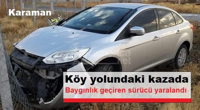 Karaman'da kaza yapan otomobilin sürücüsü baygınlık geçirdi